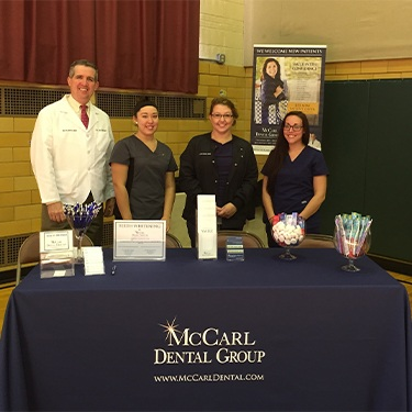 Doctor Jay McCarl and three dental assistants at Greenbelt Health and Wellness fair