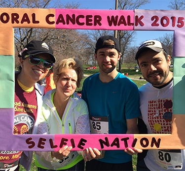 Four participants at oral cancer walk taking selfie