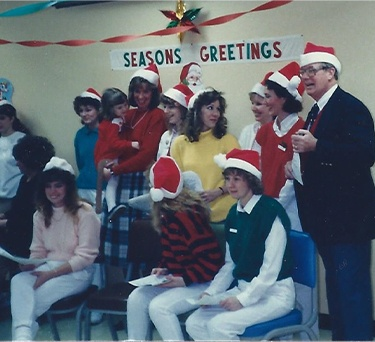The McCarl Dental Group dentists and team caroling in 1997