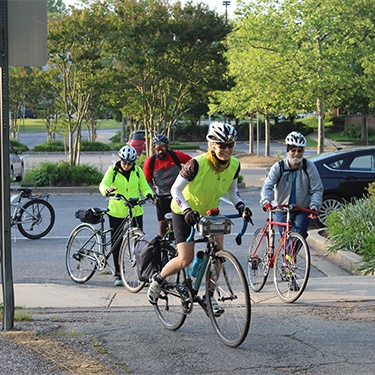 Group of bike to work week participants riding to work