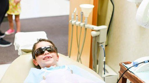 Smiling child in dental chair  for dental checkup