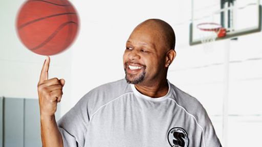 Smiling patient holding basketball