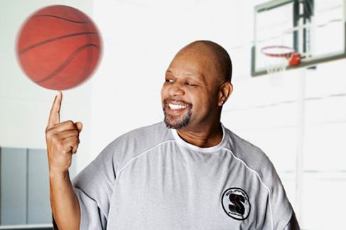 Norm smiling and holding basketball