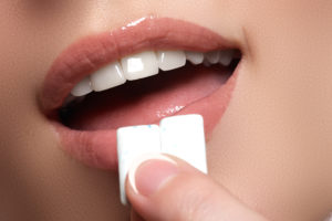 Woman chewing teeth whitening gum
