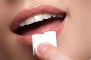 Woman chewing teeth whitening gum