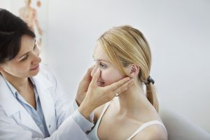 Dentist checking woman's facial shape
